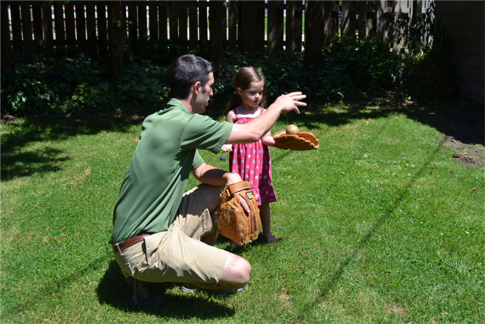 Josh teaching Anneliese how to throw